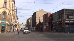 Articulated tram exchanges passengers at a stop at Matisa Street Stock Footage