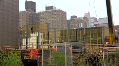 Workers at the construction site from the High Line Park. NYC, New York, USA. Stock Footage