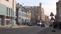 Tram train runs along cobble-paved Kr. Barona Street in city center Stock Footage