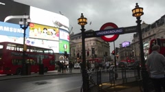 Cars, people and buses in the evening at London's Picadilly Circus Stock Footage
