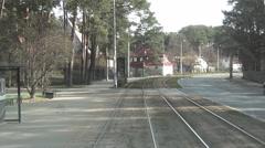 Sideway tramline segregation in cottage borough, vehicle shot from rear platform Stock Footage