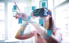 Technology interface  against woman using a virtual reality device Stock Photos