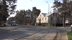 Articulated tram turns left in Mezaparks cottage residential borough Stock Footage