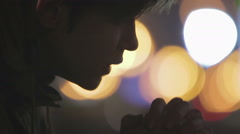Desperate young man praying in church, asking for god's forgiveness and support - stock footage