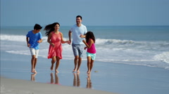 Young Hispanic family spending leisure time by the ocean outdoor Stock Footage