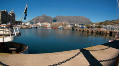 Time lapse of V&A Waterfront in Cape Town with Table Mountain in the background Stock Footage
