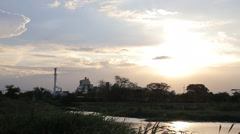 Scenery of sugar factory moment was going to sunset - stock footage
