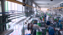 Room With a Complex System of Pipes. View From Left to Right. Power Station Stock Footage