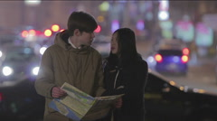 Confused couple of students checking map to find right direction, travel abroad Stock Footage