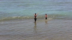 Southern puerto rico coastal beach kids playing Stock Footage