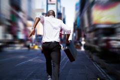 Businessman jumping a hurdle against blurry new york street Kuvituskuvat