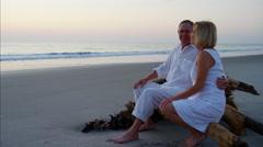 Loving Caucasian seniors on beach vacation at sunset Stock Footage