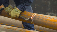 Worker Welding Pipe. Rusty Pipes. Welding Works. Closeup Stock Footage