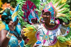 Women Wearing Elaborate Feathered Costumes Celebrate Caribbean Culture Stock Photos