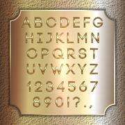 Vector gold coated alphabet letters, digits and punctuation on brass background Stock Illustration