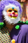 Man Wearing Colorful Clown Costume And Mask Celebrates Caribbean Culture Stock Photos