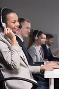 Friendly work enviroment in call center - stock photo