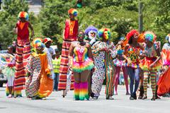 People Wearing Clown Costumes Walk In Caribbean Culture Parade Stock Photos