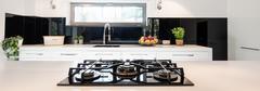 Impressive kitchen design in black and white - stock photo