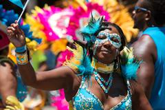 Woman Wearing Costume Participates In Parade Celebrating Caribbean Culture Stock Photos