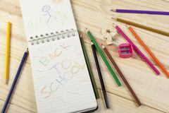 Notepad with a colourful back to school message on it - stock photo
