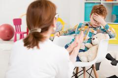 Fighting his boredom to reach final therapy results Stock Photos