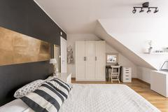 Attic bedroom in black and white Stock Photos