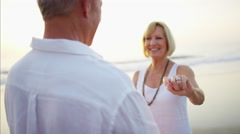 Active Caucasian seniors dancing together on the beach Stock Footage