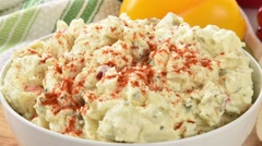 Dolly out shot on potato salad Stock Footage