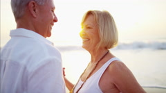 Mature Caucasian couple enjoying dancing together on the beach Stock Footage