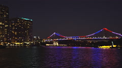 Slow pan of the story bridge in brisbane at night Stock Footage