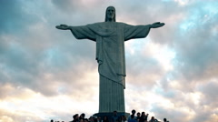 Visitors to christ the redeemer statue in rio at sunset Stock Footage