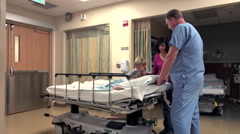 Medical Staff and Nurse Taking Care of Little Boy In Hospital Stock Footage