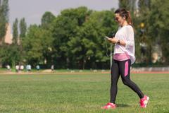 Young athletic girl walking grass Stock Photos