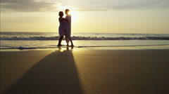 Silhouette of retired Caucasian couple dancing on the beach at sunset Stock Footage