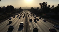 Highway congested with traffic in Los Angeles at dusk - stock footage