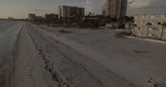 Aerial Of Homes On Buildings On Beach Lido Key Sarasota Florida At Sunset Stock Footage