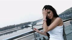 Beautiful charming young brunette woman in white shirt posing standing on modern Stock Footage