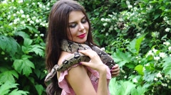 The girl with a snake around his neck . Unity with nature - stock footage
