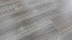 Rotating shot of beautiful laminate wood flooring Stock Footage