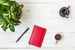 Red notepad and stationery on white boards Stock Photos