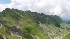 Passage road traversing mountains , aerial view Stock Footage