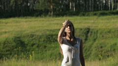 Young beautiful woman playing with her long hair, outdoors - outside. Stock Footage