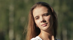 Beautiful young woman on field in summer Stock Footage