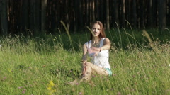 Beautiful woman waving hand in the park - stock footage