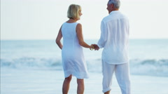 Happy Caucasian seniors dancing outdoor on the beach Stock Footage