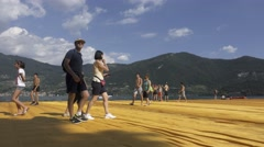 "Christo and Jeanne-Claude's ""Floating Piers"" - People Walking Stock Footage"