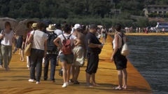"Christo and Jeanne-Claude's ""Floating Piers"" - People Walking Slow Motion Stock Footage"