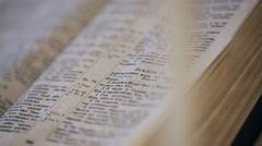 Opened Bible lies on the desk prepared for ceremony Stock Footage