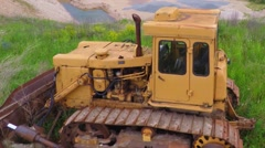 Old yellow dozer in a quarry / mine. Summer nature landscape. Aerial footage. Stock Footage